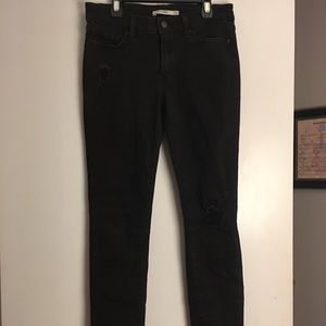 Black Levi's 711 Distressed Skinny Jeans